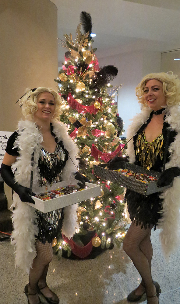 1920s girls distributing candy at Festival of Trees event