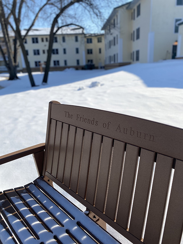A Moravian foundation donor bench outside in the snow